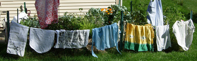 Fonts Cafe aprons on a backyard clothesline